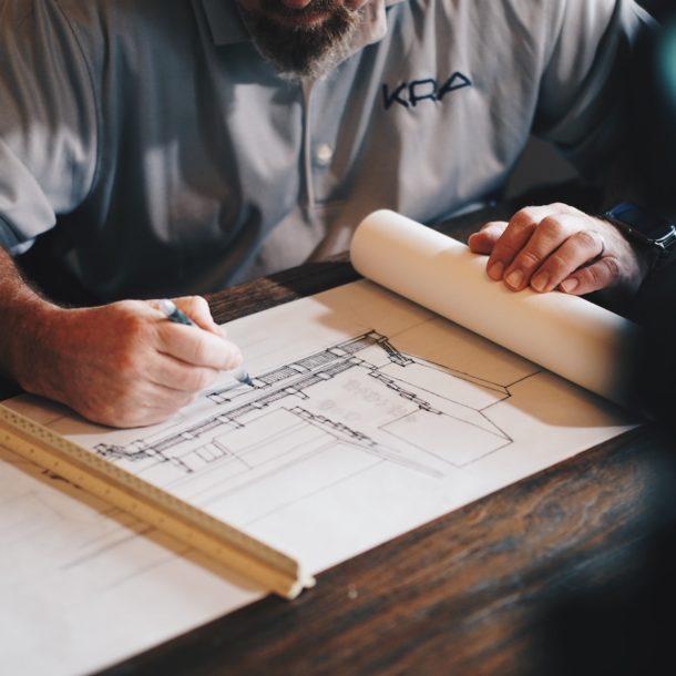Man working on construction blueprint
