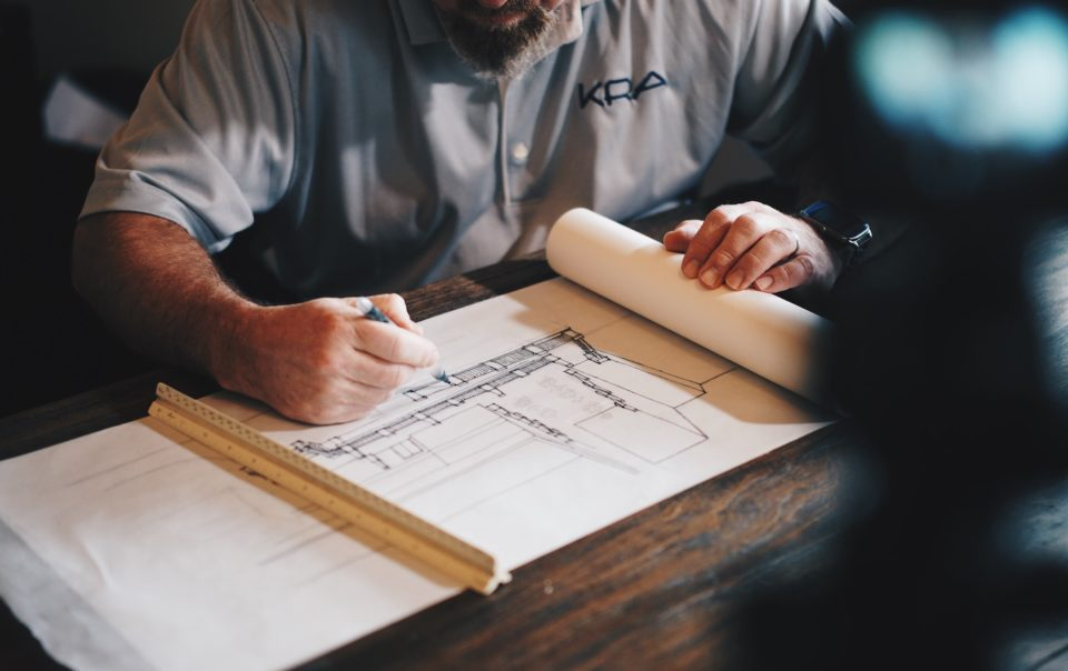 Man working on construction blueprint