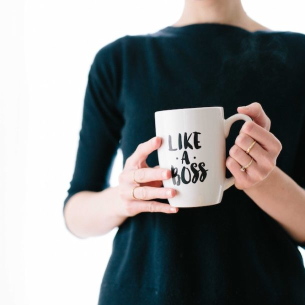 "Woman holding a ""LIKE A BOSS"" mug"